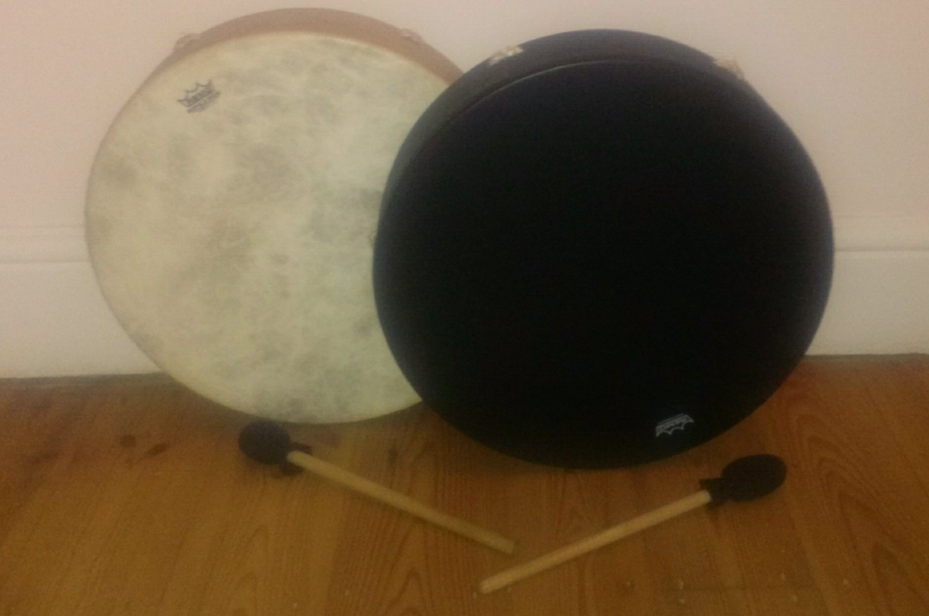 A black drum and a white drum