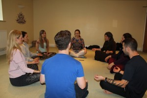 group sitting in meditation